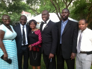 African professionals, including Sheikh Moussa Dremmeh (2nd right), UAC leader and Dr. Abdoulaye Balde (r.) flank Dr Bola (ctr.) at the outdoor fundraising reception held on Saturday, July 6.